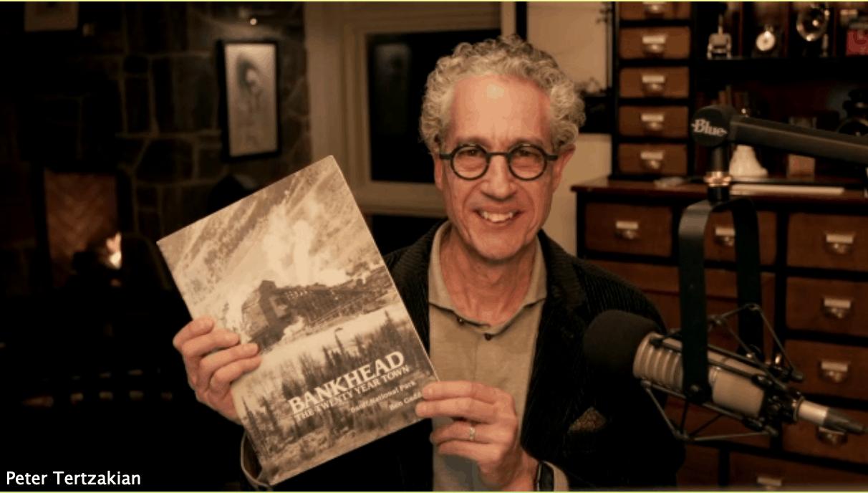 Peter Tertzakian holds up Bankhead: The Twenty Year Town book